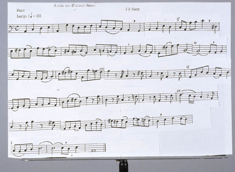 photo of a large sheet of paper with music on a music stand.